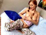 Red haired teenage girlfriend in pigtails Edith showing off her big knockers