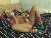 Trashy brunette teen in socks rubbing her shaved beaver