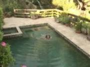 Gorgeous brunette amateur babe Rita Faltoyano tease a black stud with her assets outdoors