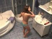 Splendid brunette voyeur nymphet Lilia gets ready for a bath on hidden cam