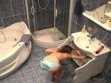 Seductively brunette amateur voyeur babe Lilia naked in bathroom