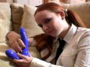 Redhead teen ex-girlfriend in pigtails Halo sucking a big blue toy on the couch