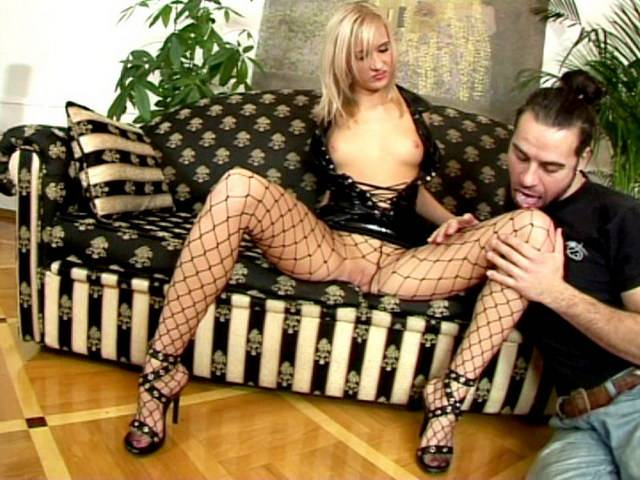 Blonde Russian temptress in latex dress and fishnets Belinda gets wet beaver licked on the couch