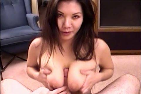 Topless Asian chubby girl performs Tit Job